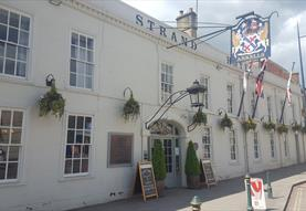 Lansdowne Hotel Calne Exterior with Flags and Summetime View