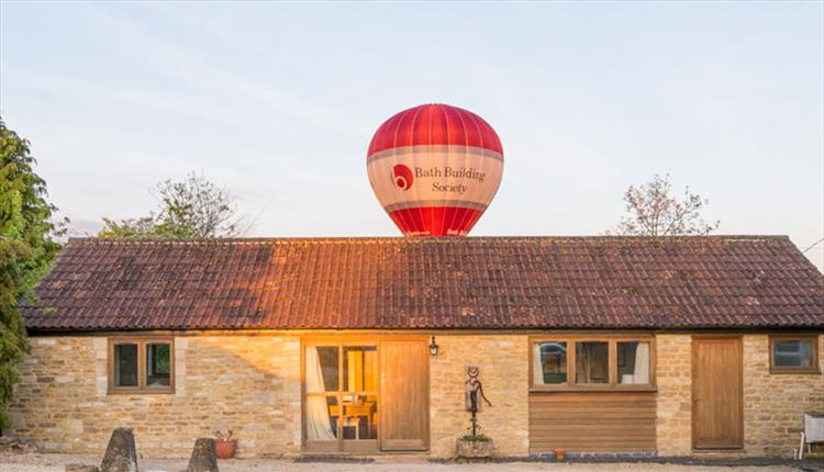 FRONT OF WHITLEY COACH HOUSE BATH BALLOON ABOVE AT DUSK